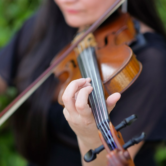 String musician playing the violin during a ceremony