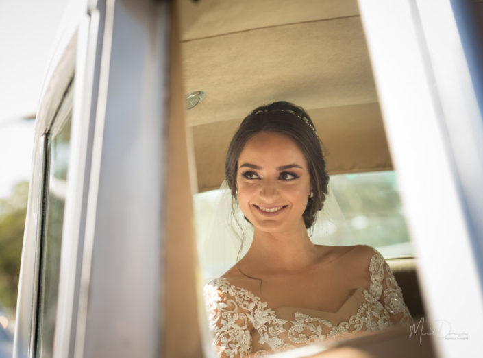 A bride smiles while looking to the side on her wedding day