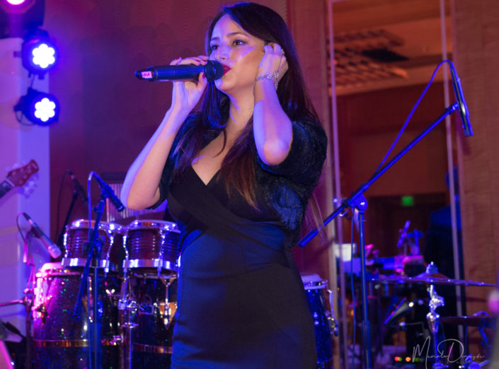 A female singer from the band Social Sound performs at a wedding