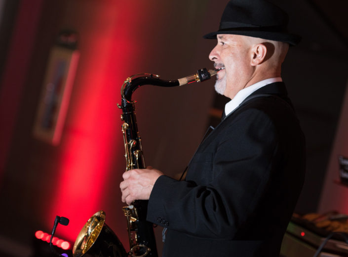 A jazz player plays the saxophone during a corporate event