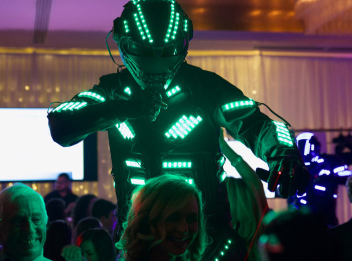 A green LED Robot performs during a corporate event