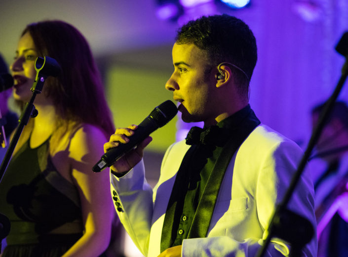 A singer from the band, Social Sound performs during a wedding