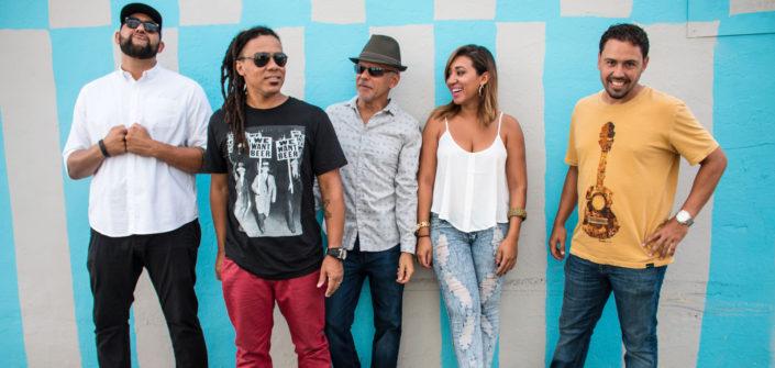 A group picture of Samba Funk, a Brazilian Samba band