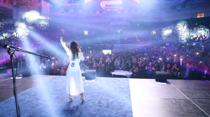 Picture of a singer from Dream On performing for a large live audience