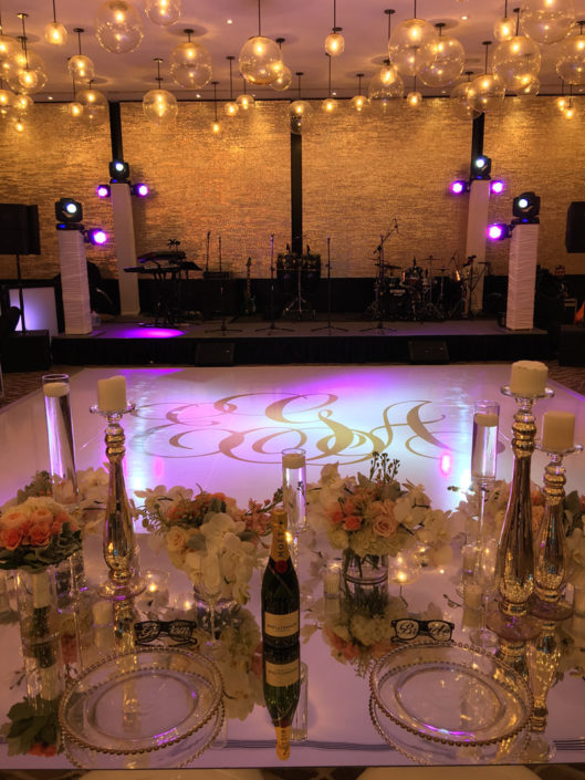 ample of Al-Vento Event production services - Elegant table for the bride and groom, overlooking the dance floor and stage