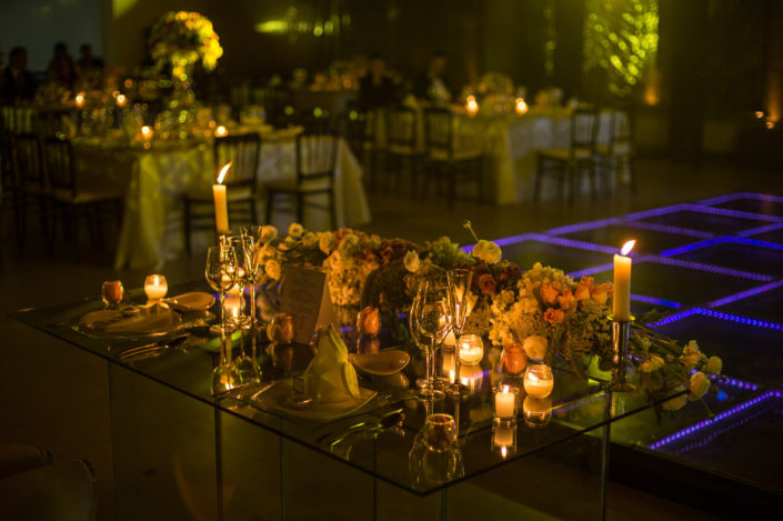Example of Al-Vento Event production services - Elegant, candle-lit dinner table with flowers and wine glasses.