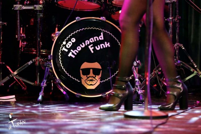 Close up shot of Motown Funks drum set with female singers legs in the forground