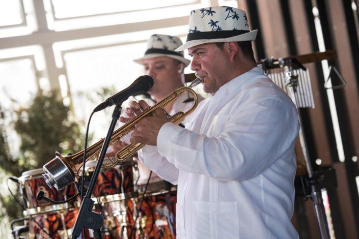 The Cuban Latin Band horn players performing traditional Cuban music