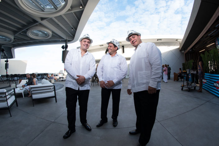 Three members of The Cuban Latin Band posing at an event