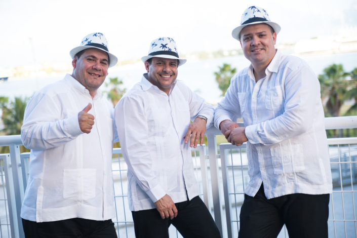 Three members of The Cuban Latin Band posing for a shot