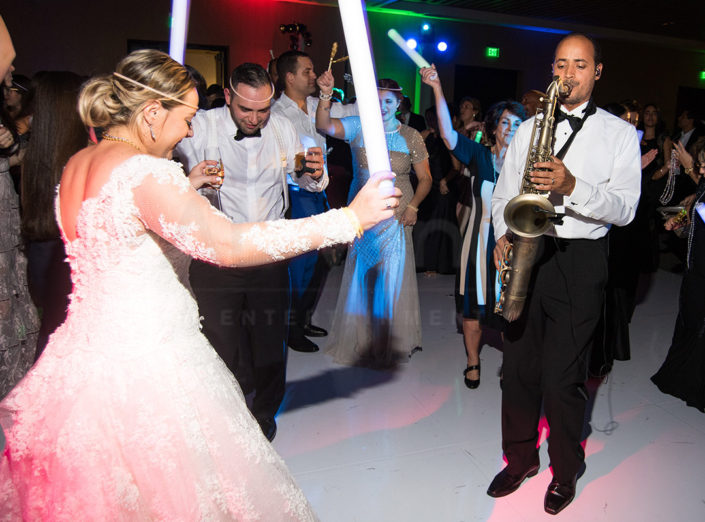 Bride and Groom dance to music performed by DJ Fusion - a live DJ and Band.