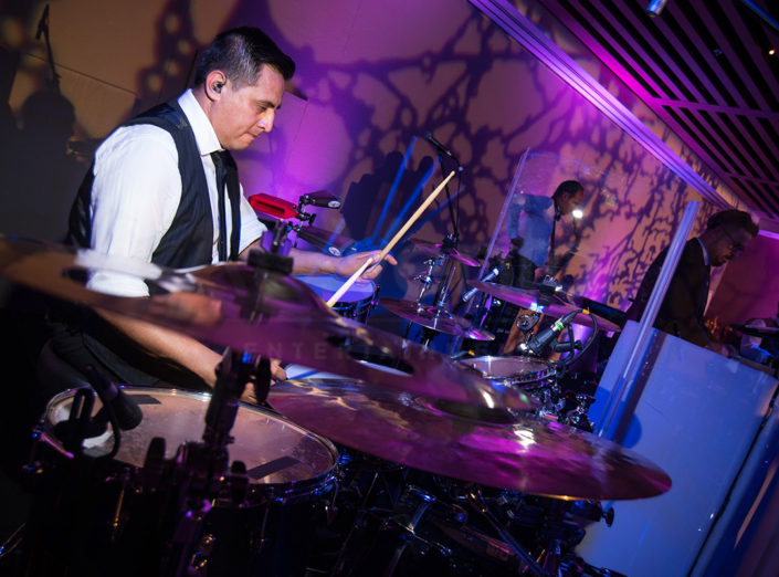 A drummer performs at a wedding as part of DJ Fusion