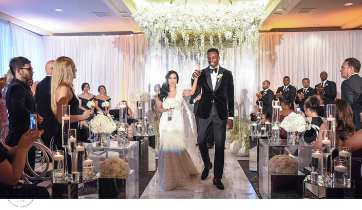 Jeff Green and Stephanie Hurtado walk down the aisle